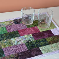 Purple brick batik table runner